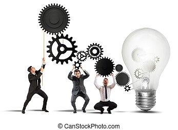 Teamwork powering an idea with gear system