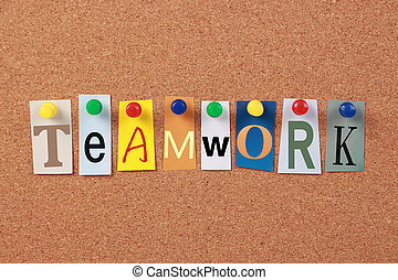 The word Teamwork in cut out magazine letters pinned to a corkboard.