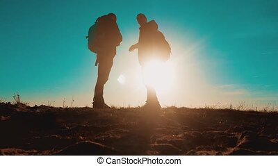 teamwork smartphone navigation. two tourists hikers men with...