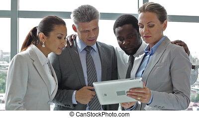 Teamwork solution - Multi-racial team considering the best...