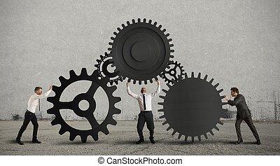 Teamwork - Concept of teamwork with gear system