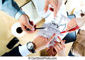 Teamwork - Image of three business people�s hands pointing...