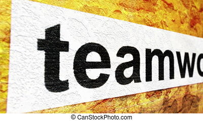 Teamwork text on grunge background