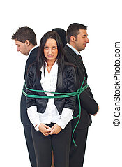 Teamwork tied up - Teamwork of business people tied in a...