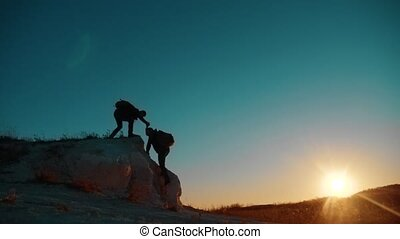 Teamwork tourists. friendship hiking help each other trust...