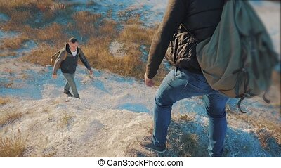 Teamwork tourists. slow motion video. friendship hiking help...