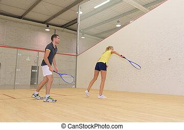 teamwork while playing squash