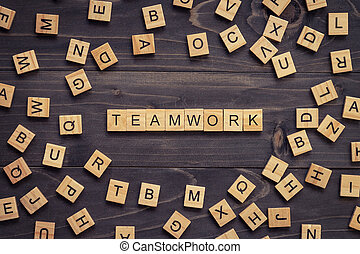Teamwork wood text and wood block on table for business concept.