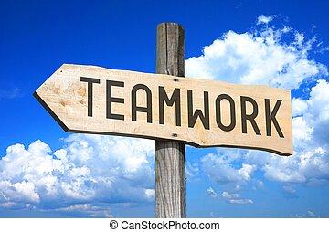 Teamwork - wooden signpost
