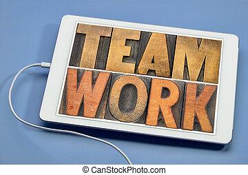 teamwork word in wood type on tablet