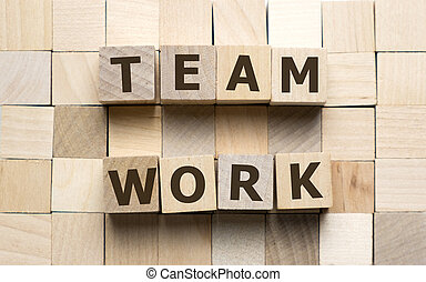 Teamwork word made from wooden cubes with letters alphabet