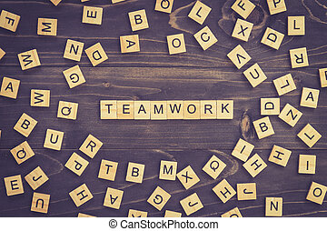 Teamwork word wood block on table for business concept.