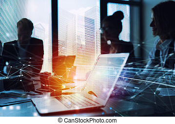 Teamwork works with a laptop. Concept of internet sharing and interconnection. double exposure