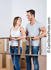 Teamwork - young couple moving house