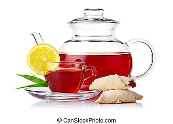 Teapot and cup of black tea with crescent and lemon slice isolated on white background