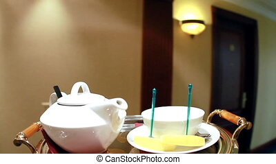 Teapot and cup on a tray
