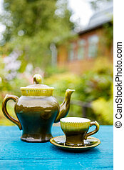 Teapot and cups on table