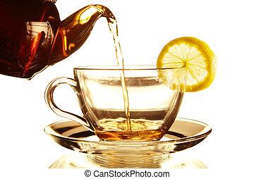 Teapot and Teacup - Teapot and glass cup of tea with lemon...