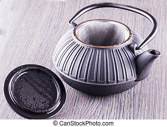 Teapot over wooden table