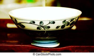 Teapot pouring tea,ancient customs