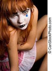 tear - sad clown-face makeup girl