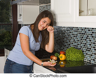 Tears in the kitchen - Young woman crying tears while...