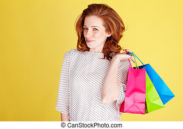 Teasing Woman With Colourful Bags