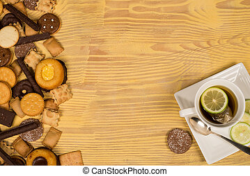 Teatime cookies - Assorted tea time cookies next to a cup of...