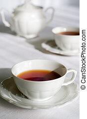 Teatime - Tea set - two porcelain cup of tea with sugar-bowl...