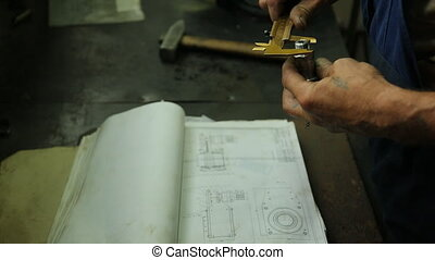 tech mechanics hand, the Chief Inspector or just an expert checks the item after the repair.