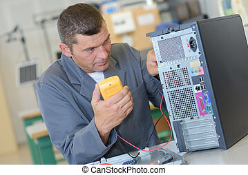 techie technician using a voltmeter