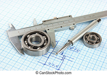 Technical drawing and callipers with bearing on graph paper