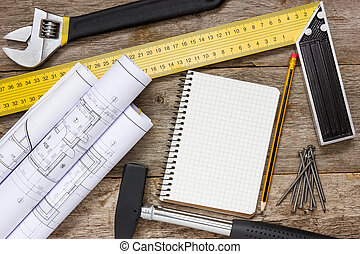 Technical drawing and tools with blank notebook