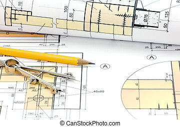 technical project drawings, rolls of blueprints and drawing tools