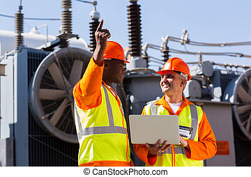 technical workers discussing work