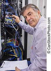 Technician adjusting server wires