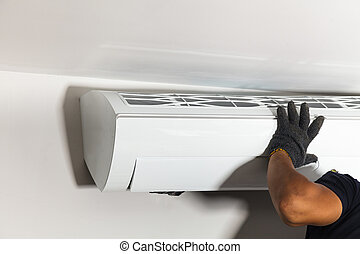 Technician air conditioning installs the new air conditioner