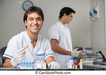 Technician Analyzing Sample In Lab