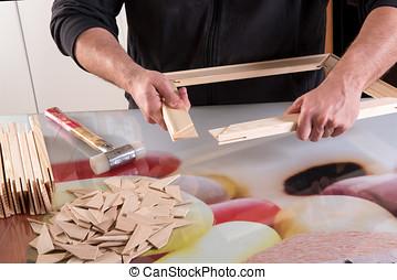 Technician assembling a wood frame