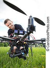 Technician Assembling Camera On UAV Drone