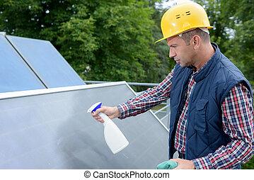 technician checks the maintenance of the solar panels