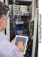 Technician controlling the server with a digital tablet