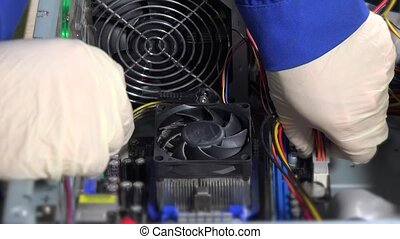 Technician disconnects power cable pins from computer motherboard and remove RAM