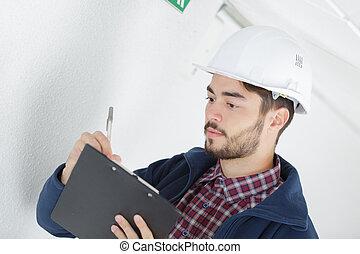 technician doing a bidding estimate