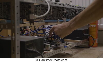 Technician engineer man checking cable connections and...