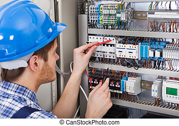 Technician Examining Fusebox With Multimeter Probe - Side...