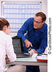 Technician explaining to assistant