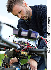 Technician Fixing Camera On UAV Drone - Closeup of young...
