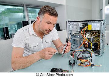 technician fixing computer part