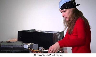 Technician girl installing motherboard to desktop pc case....